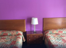2 double beds, nightstand with storage drawers and bedside light